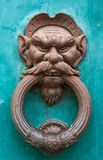 Ancient iron doorknocker face Royalty Free Stock Images