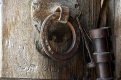 Ancient Ironwork on the Massive Wooden Door of the Church of the Holy Sepulchre, Jerusalem, Israel. Detailed view of the inscriptions and carvings around the Royalty Free Stock Photography