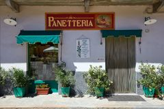 Ancient Italian bakery with plants in Barolo town Royalty Free Stock Photography