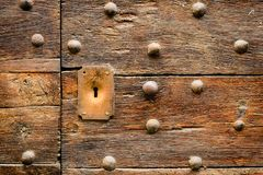 Ancient Italian door in Tuscany. Keyhole useful for concepts stock photo