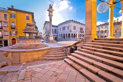 Ancient Italian square arches and architecture in town of Udine. Friuli Venezia Giulia region of Italy stock photos