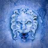 Ancient italian stone fountain with lion head Royalty Free Stock Image