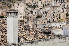 Ancient Italian village. The chimney of the fireplace on the roof. Royalty Free Stock Image