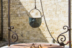 Ancient Italian water well with metal bucket Royalty Free Stock Image