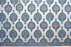 Ancient Iznik lapis tiles with floral pattern close up background. Ancient famous Iznik lapis tiles with floral pattern close up background stock photo
