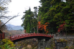 Ancient Japanese red arc bridge and Autumn leaves in Sendai Royalty Free Stock Photos