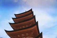 Ancient Japanese wood pagoda with blue sky. In Miyajima island Stock Photos