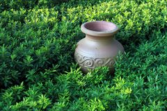 Ancient jar in grassland,horizontal precise compos royalty free stock photo