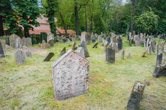 Ancient Jewish cemetery, Old Prague. Ancient Jewish cemetery with detailed view of tombstones and engravings and symbols. Also known as Jewish Garden. Old Prague Stock Photo
