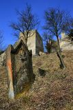 Ancient jewish tombstone on jewish cemetery in front of castle Beckov, central Slovakia. Shot during winter season, early march 2017 royalty free stock photo