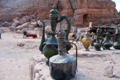 Ancient kettles and coffee pots. Ancient traditional lamps, kettles and coffee pots in lost town Petra Stock Photos