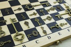 Ancient keys on a chessboard Stock Images