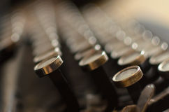 Ancient keys. An old typewriter in blurry light. You can feel the huge amount of typed words Royalty Free Stock Image