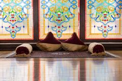 Ancient Khans or kings room interior with network ornamental window, carpets and pillow with Traditional artifacts. Ancient eastern interior design Stock Photos