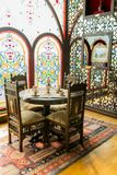 Ancient Khans or kings room interior with network ornamental window, Table and chairs. Ancient eastern interior design Royalty Free Stock Images