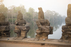 Ancient Khmer architecture. Huge carved Buddha faces of Bayon temple at Angkor Wat complex Stock Photography