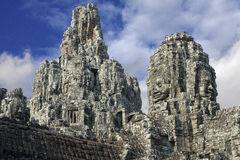 Ancient Khmer architecture. Huge carved Buddha faces of Bayon temple at Angkor Wat complex Stock Photo