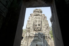 Ancient Khmer architecture. Huge carved Buddha faces of Bayon temple at Angkor Wat complex Royalty Free Stock Photo