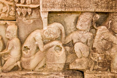 Ancient Khmer carving lice picking Royalty Free Stock Photo