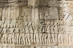 Ancient Khmer religious parade frieze Royalty Free Stock Photo