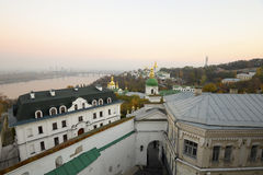 Ancient Kiev-Pechersk Lavra and beautiful evening Dnieper river  in a pink haze Stock Image