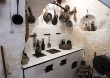 Ancient kitchen inside Casa Grotta di vico Solitario Matera, Itay. Pictured is an ancient kitchen inside of a typically furnished cave dwelling in Matera, Italy stock photography