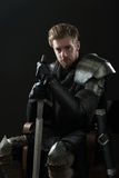Ancient knight in metal armor Stock Photography