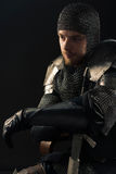 Ancient knight in metal armor Royalty Free Stock Photography