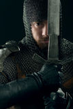 Ancient knight in metal armor Stock Images