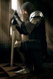 Ancient knight in metal armor Stock Photo