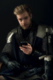 Ancient knight and mobile phone Stock Images