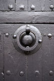 Ancient knocker on grey wooden gate close-up Royalty Free Stock Image