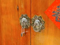 Ancient knockers and modern lock closeup Stock Photo
