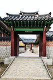 Ancient Korean gate. Brick ancient Korean gate with wooden door opened Stock Image