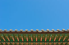 Ancient korean style roof decorative ornament. Ancient korean style under roof structural decorative ornament in blue sky Royalty Free Stock Photography