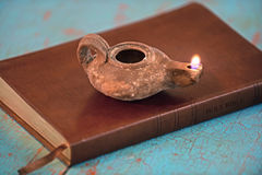 Ancient Lamp on Bible Stock Photo