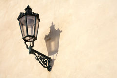 Ancient lamp. Old street lamp on a brown wall royalty free stock photo