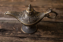 Ancient lamp on wood background Stock Photography