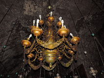 Ancient lamps hanging in the Church of the Sepulchre of Saint Mary. Ancient lamp with artistic design hanging inside the Church of the Sepulchre of Saint Mary Royalty Free Stock Photography