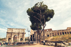 Ancient landmark Arch of Constantine and Colosseum square with tourist in Rome, Italy Royalty Free Stock Image