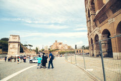 Ancient landmark Arch of Constantine and Colosseum square with tourist in Rome, Italy Royalty Free Stock Photo