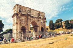Ancient landmark Arch of Constantine with tourist in Rome, Italy Royalty Free Stock Photo