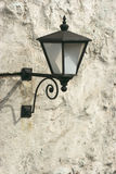 Ancient lantern on wall Stock Photography
