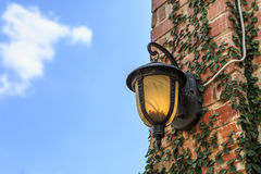 Ancient lantern on wall with blue sky Stock Images