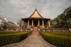 Ancient Laos art on church in Hor Phakaeo temple. Stock Photos