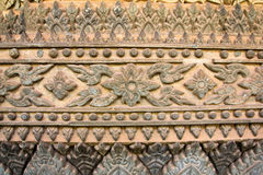Ancient Laos art wall carving in Hor Phakeaw Stock Photos