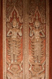 Ancient Laos art wood carving on church in Hor Phakaeo temple. Stock Image