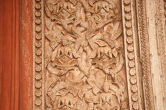 Ancient Laos art wood carving on church in Hor Phakaeo temple. Royalty Free Stock Images