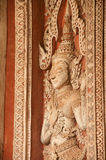 Ancient Laos art wood carving on church in Hor Phakeo temple. Royalty Free Stock Photos