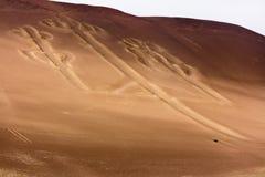 Ballestas Candelabrum Mark. Ancient large-scale geoglyph Candelabrum figure in Paracas national park Stock Photos